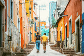 Couple walking the colorful narrow streets of Guanajuato in Mexico