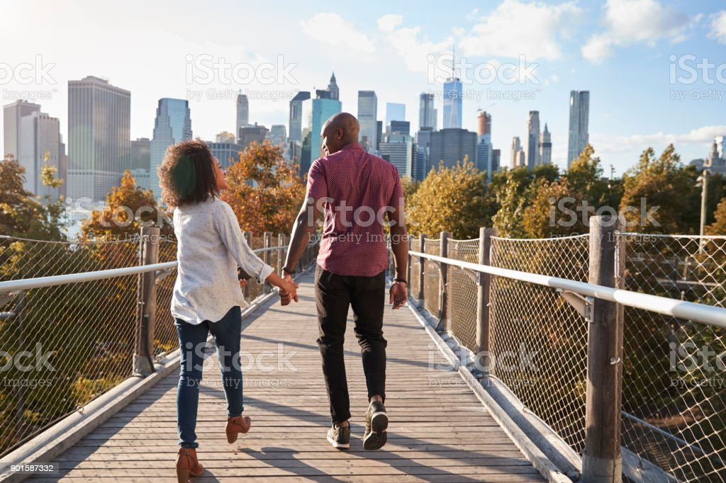 Couple Visiting New York With Manhattan Skyline In Background stock photo