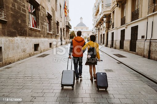 Rear view of couple arriving in Valencia early in the morning