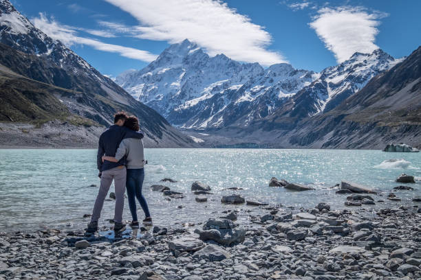 Couple visits Mount Cook, Canterbury, New Zealand stock photo