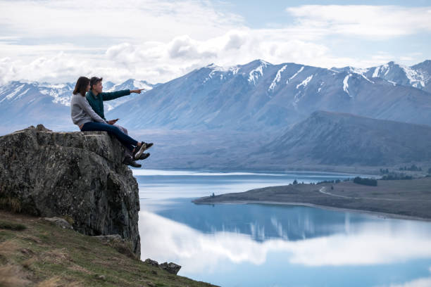 Couple visits Mount John at Tekapo, Canterbury, New Zealand stock photo
