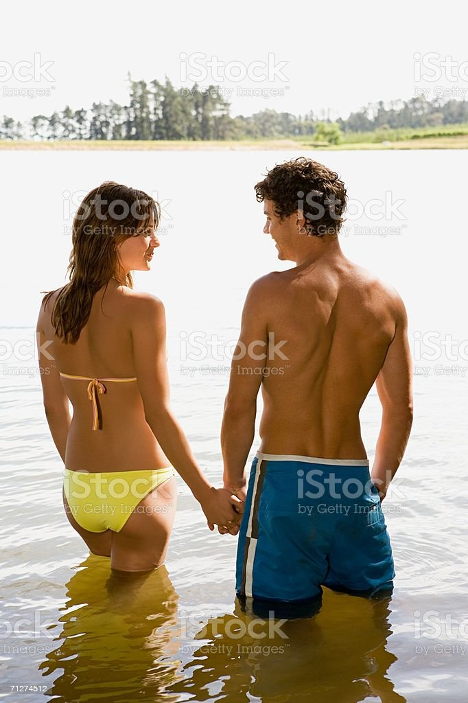 Couple wading in a lake royalty-free stock photo