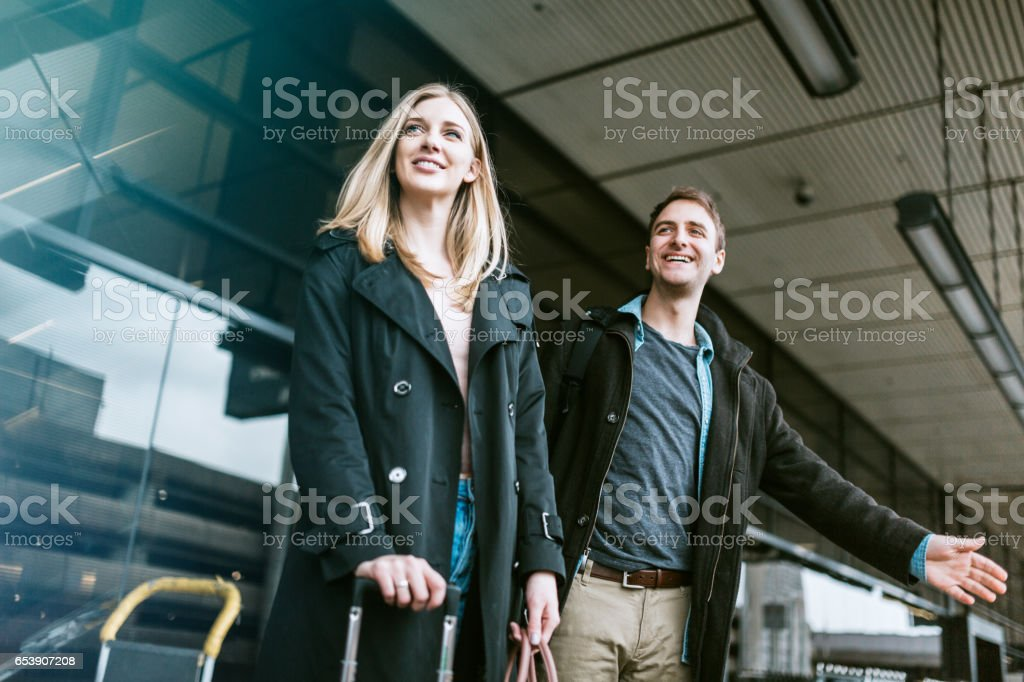 Couple Wait for Ride at Airport stock photo