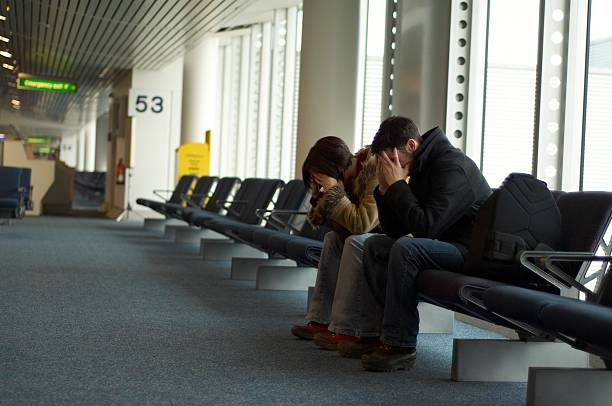 Couple waiting at an Airport stock photo