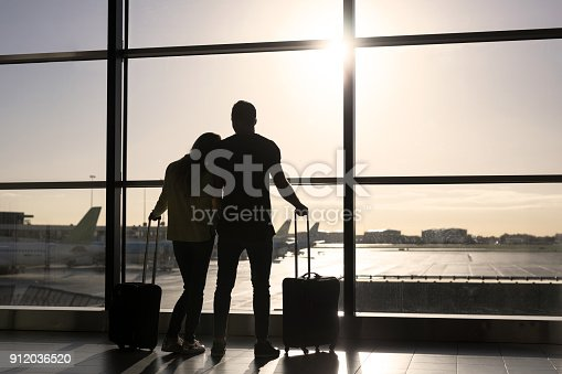 istock Couple waiting for flight in airport 912036520