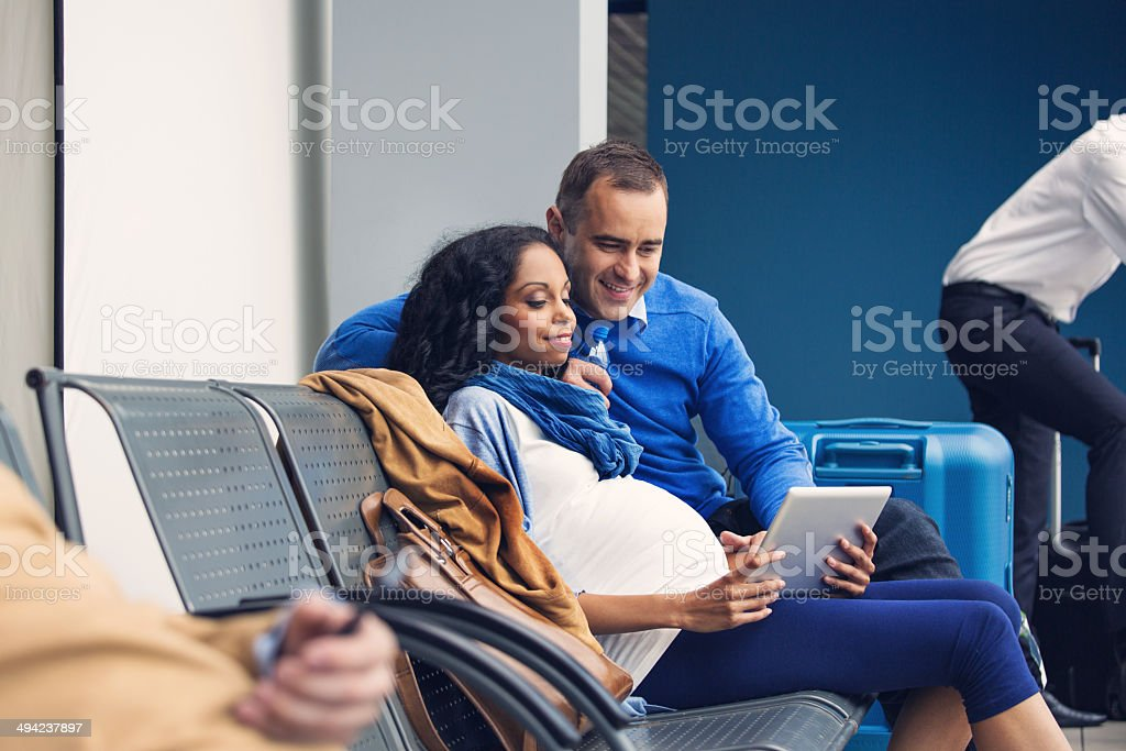 Couple waiting for flight stock photo