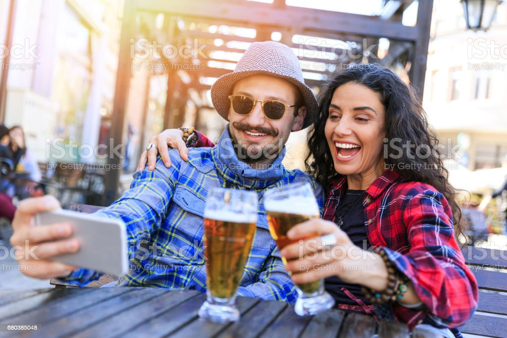 Couple waiting on rail station and making selfie royalty-free stock photo