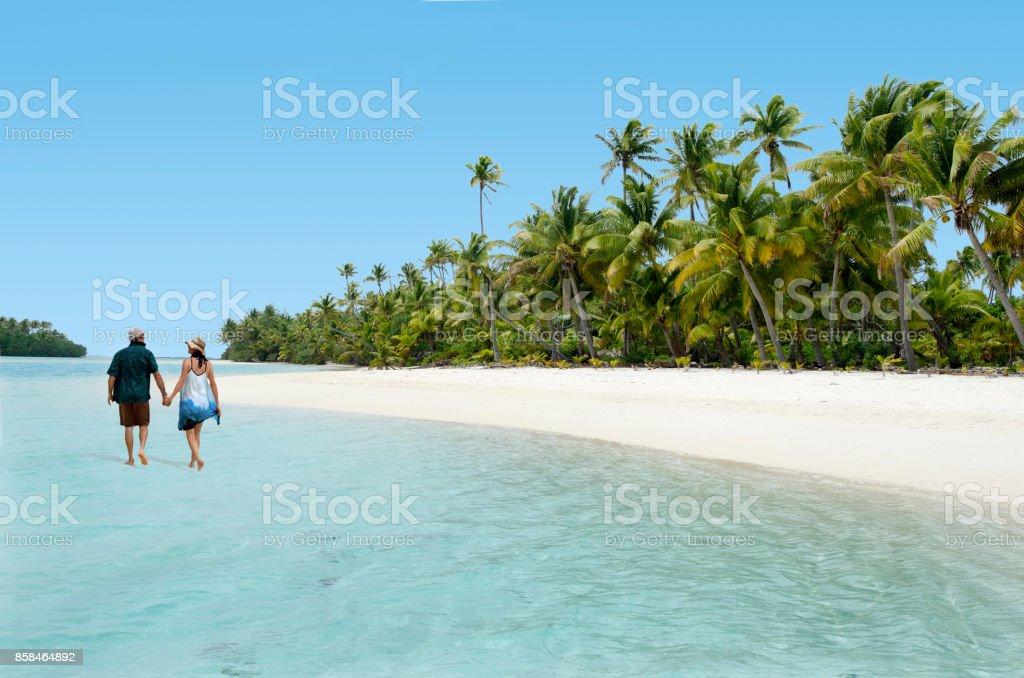 Couple Walk on Aitutaki Lagoon Cook Islands stock photo