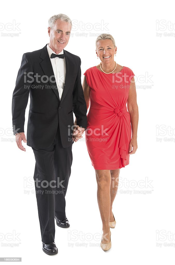 Couple Walking Against White Background stock photo