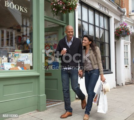 istock couple walking along street together 83315390