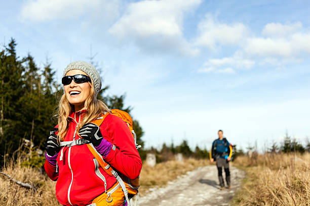 Couple walking and hiking on mountain trail stock photo