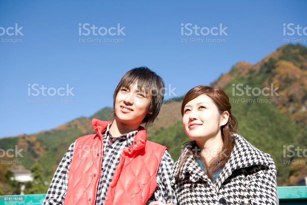 Couple walking arm in arm royalty-free stock photo