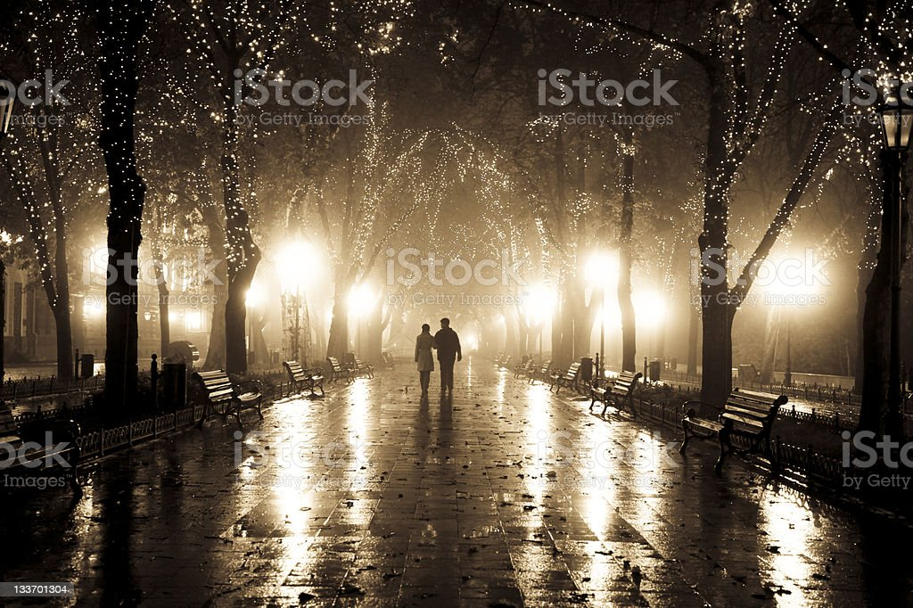 Couple walking at alley in night lights. stock photo