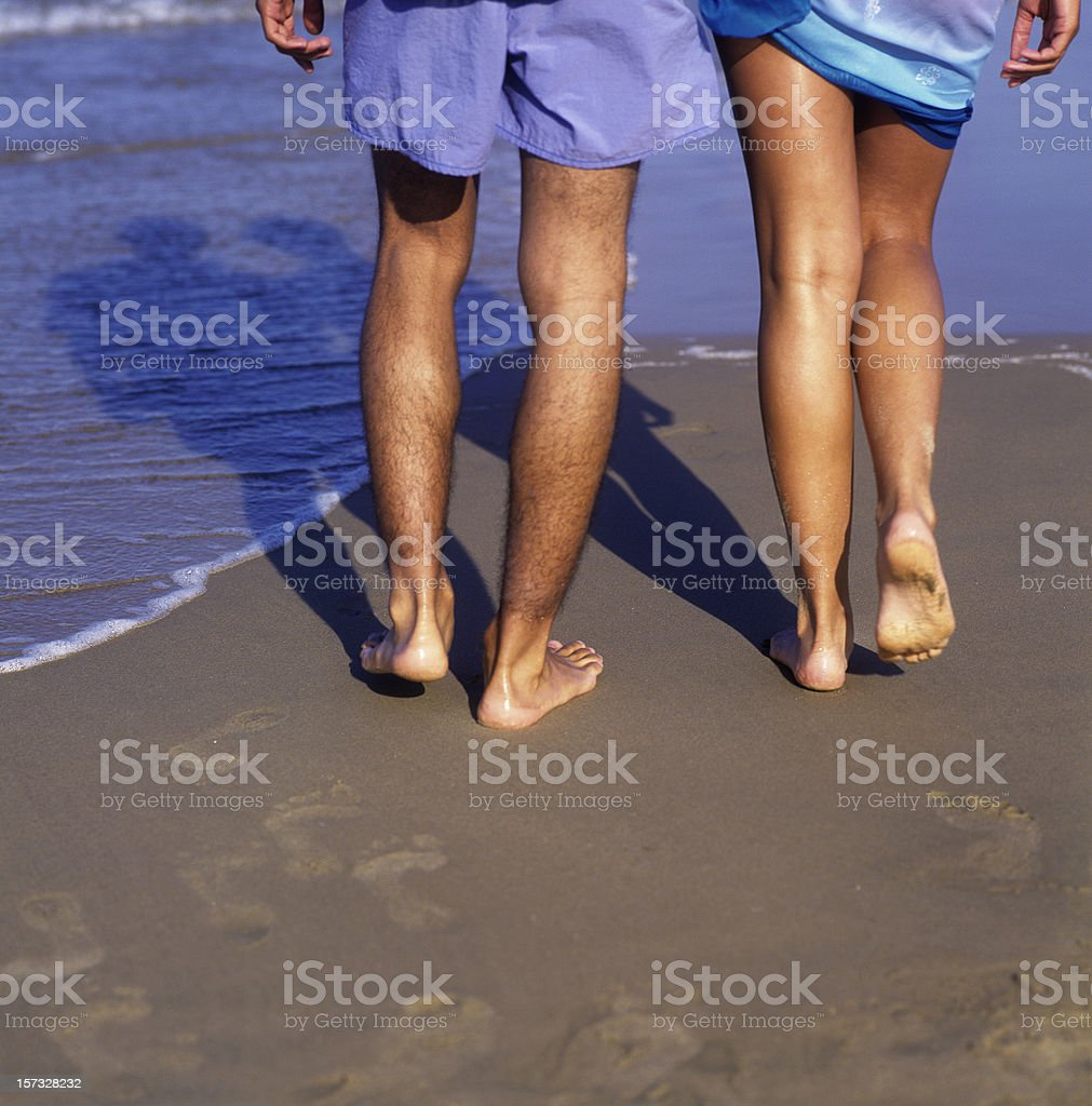 Couple walking at the beach royalty-free stock photo