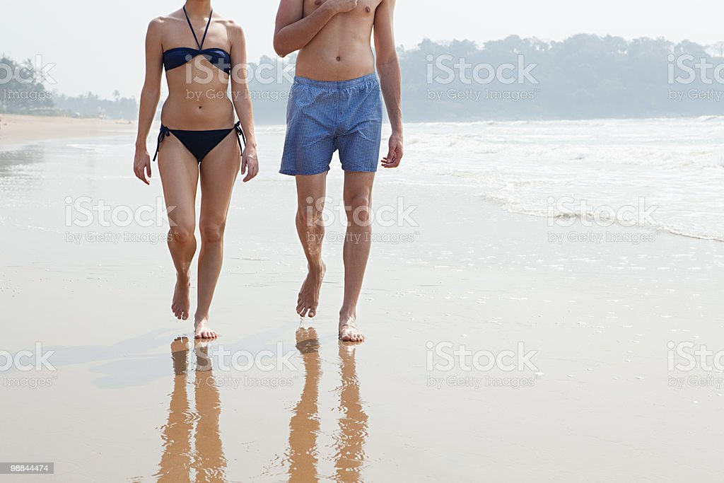 Couple walking by the ocean royalty-free stock photo