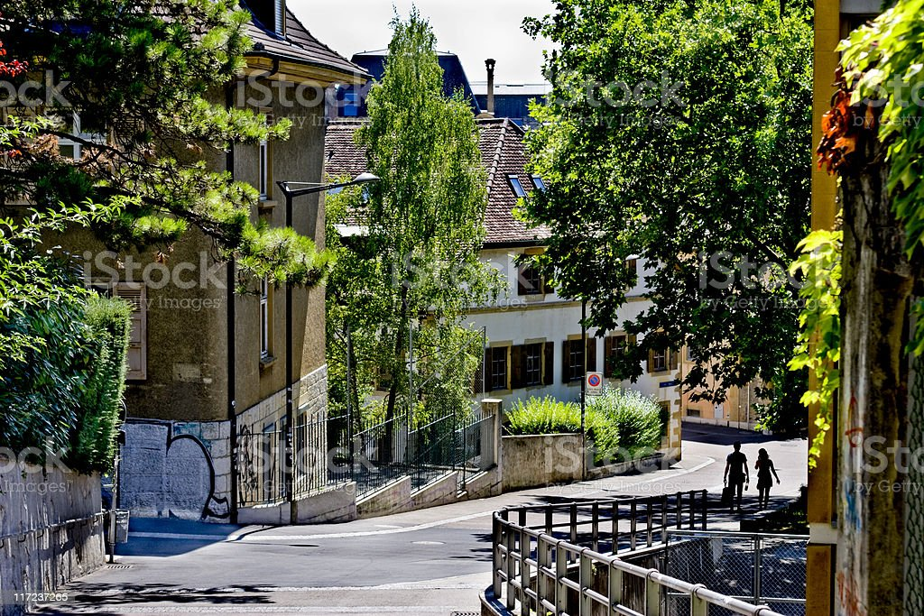 Couple Walking Down a Street in Neuchatel stock photo