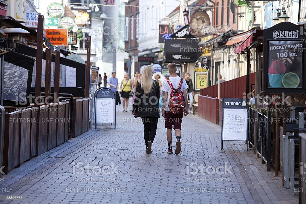 Couple walking down the Jomfru Ane Gade stock photo