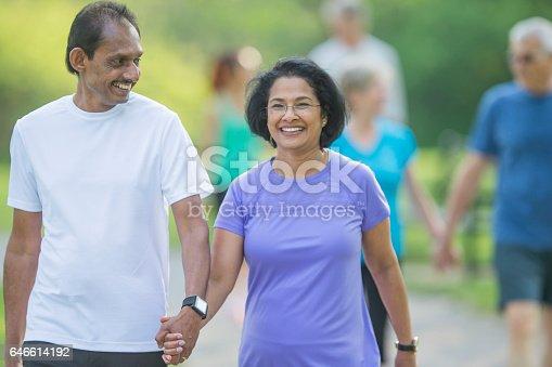 646614234 istock photo Couple Walking Hand-in-Hand 646614192