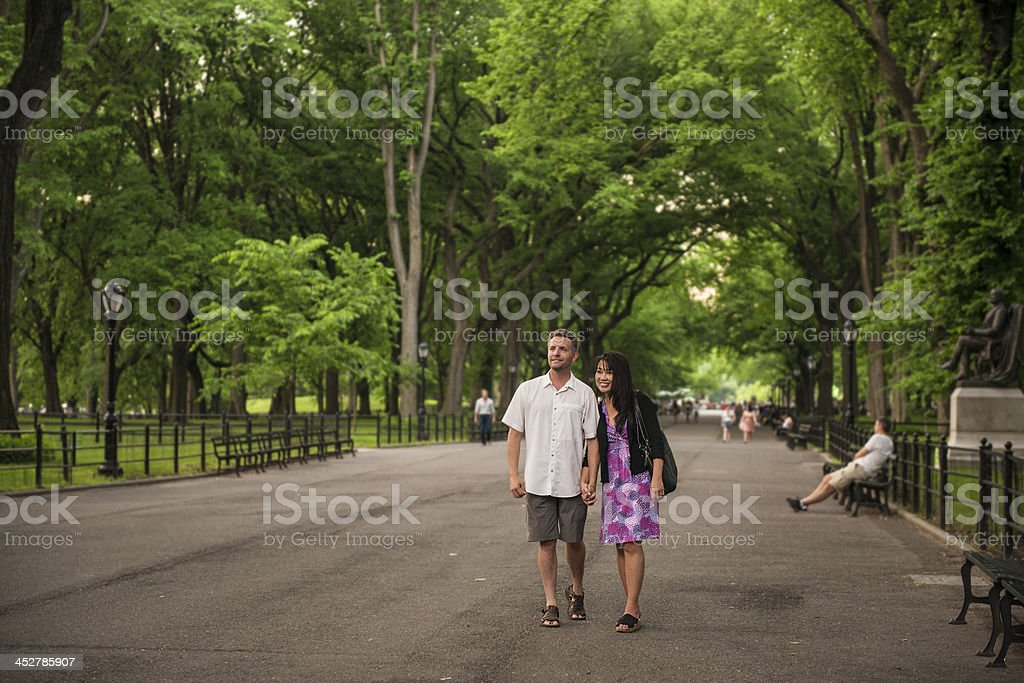 Couple Walking In Central Park royalty-free stock photo