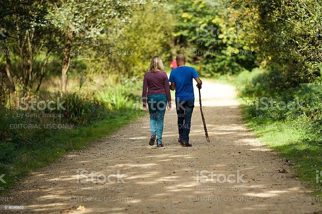 Couple Walking in Epping Forrest, London stock photo