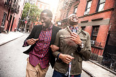 Homosexual young couple hanging out and walking in Greenwich Village - New York, USA.