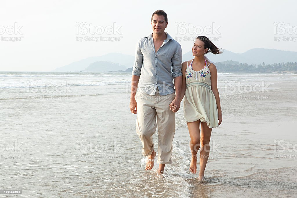 Couple walking in the sea 免版稅 stock photo