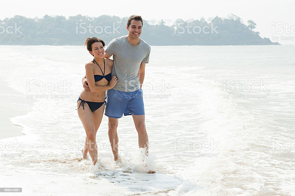Couple walking in the sea royalty-free stock photo