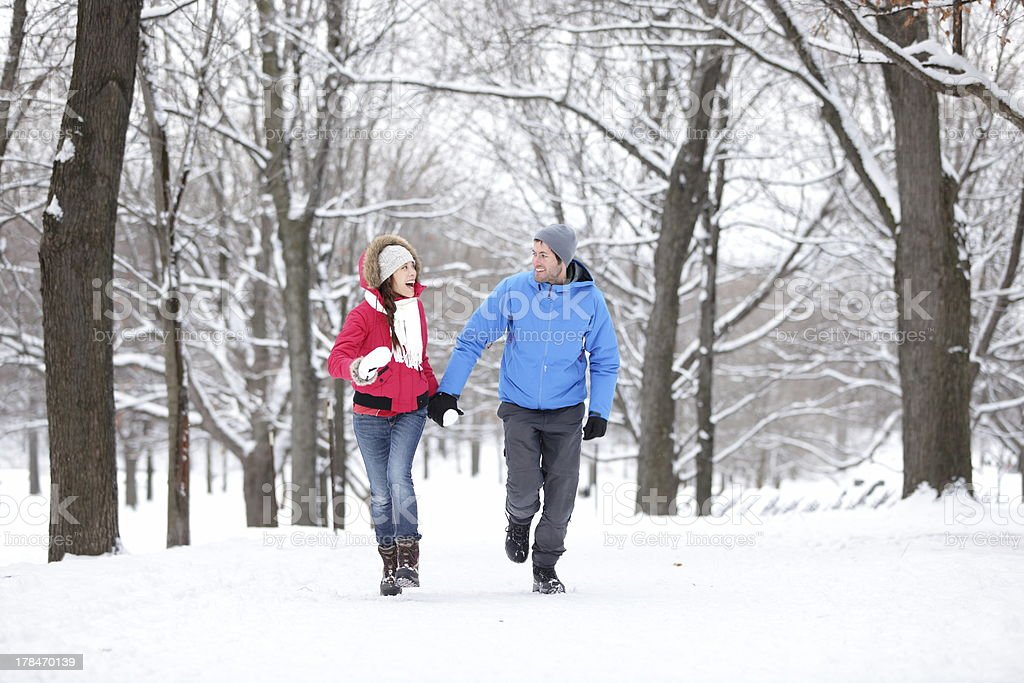 Couple walking in winter forest stock photo