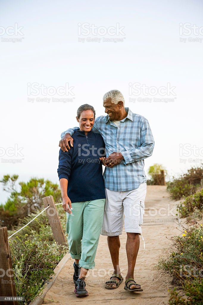 Couple walking on boardwalk. stock photo