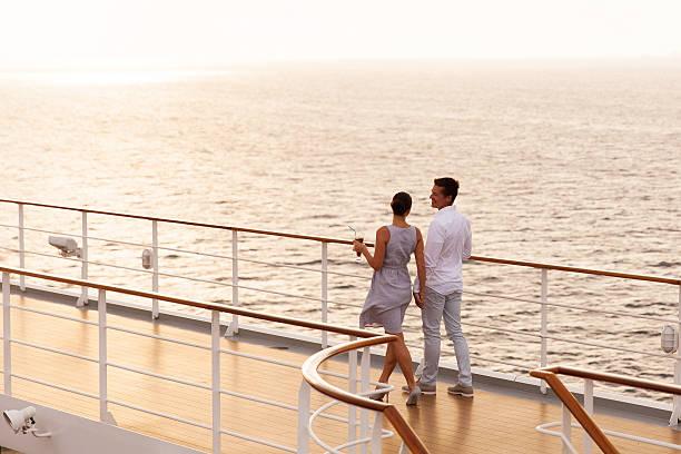 couple walking on cruise ship deck stock photo