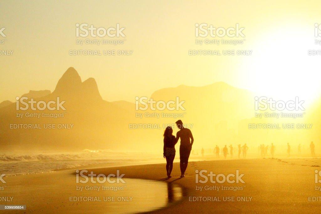 Couple walking on Ipanema´s sunshine stock photo