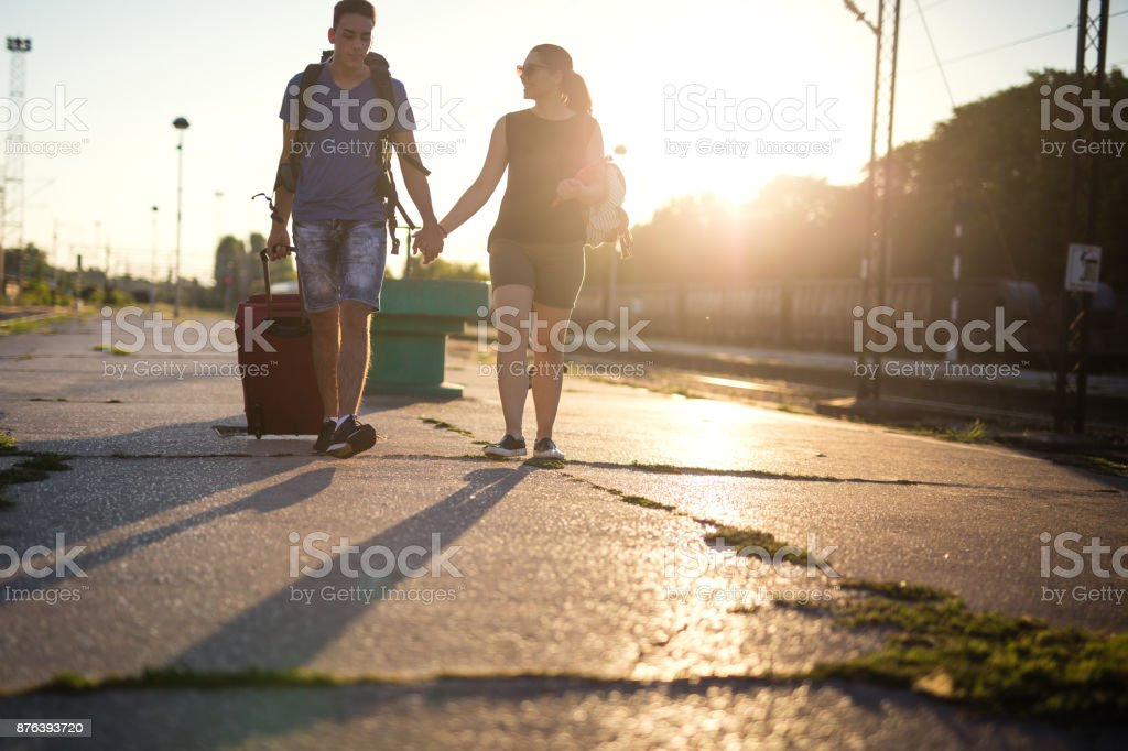 Couple walking on railway station stock photo