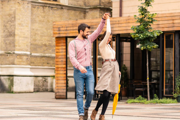 Couple walking on the street and holding hands. stock photo