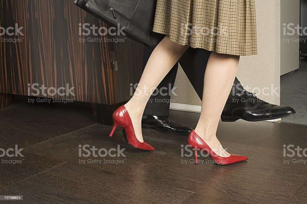 Couple walking out of room royalty-free stock photo