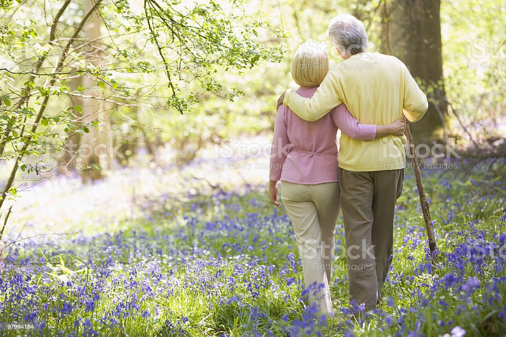 Couple walking outdoors royalty-free stock photo