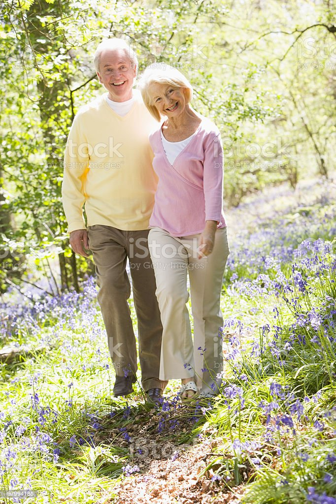 Couple walking outdoors smiling royalty-free stock photo