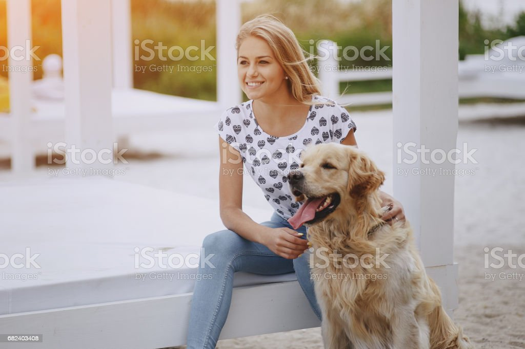 couple walking outdoors with her dog royalty-free stock photo
