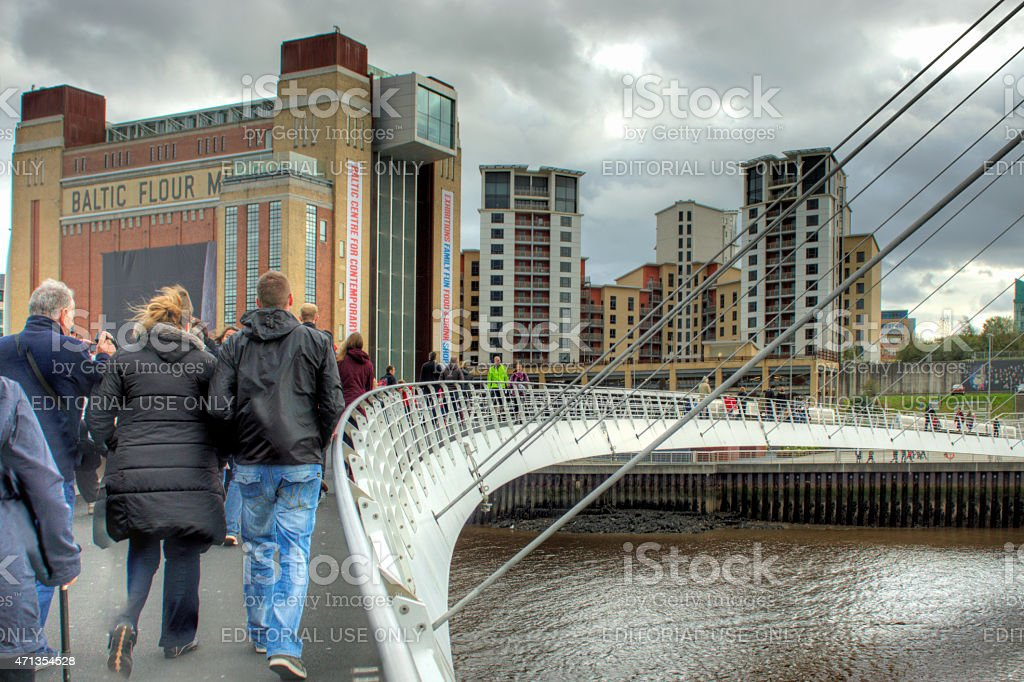 Couple walking over the Millenium Bridge stock photo
