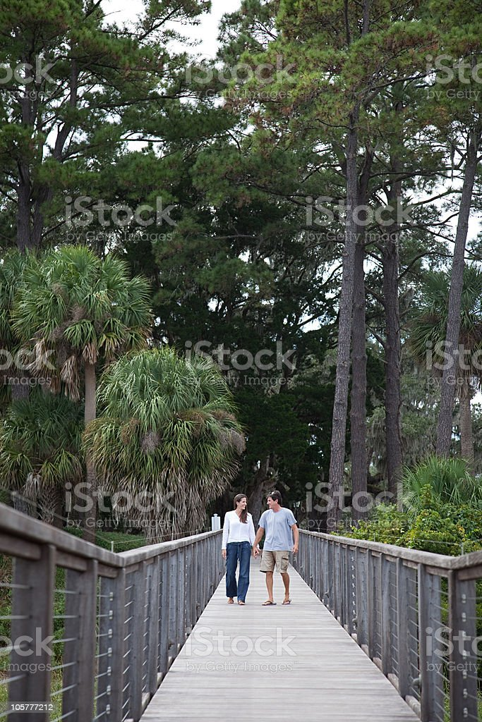 Couple walking over walkway stock photo