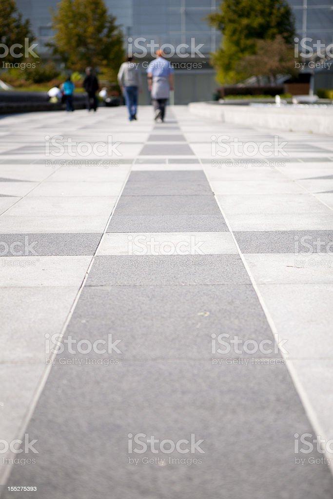 couple walking straight royalty-free stock photo