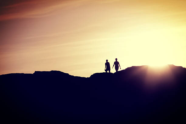 Couple Walking Together at Sunset stock photo