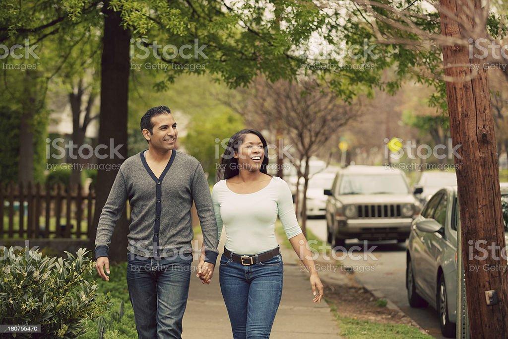 couple walking town stock photo