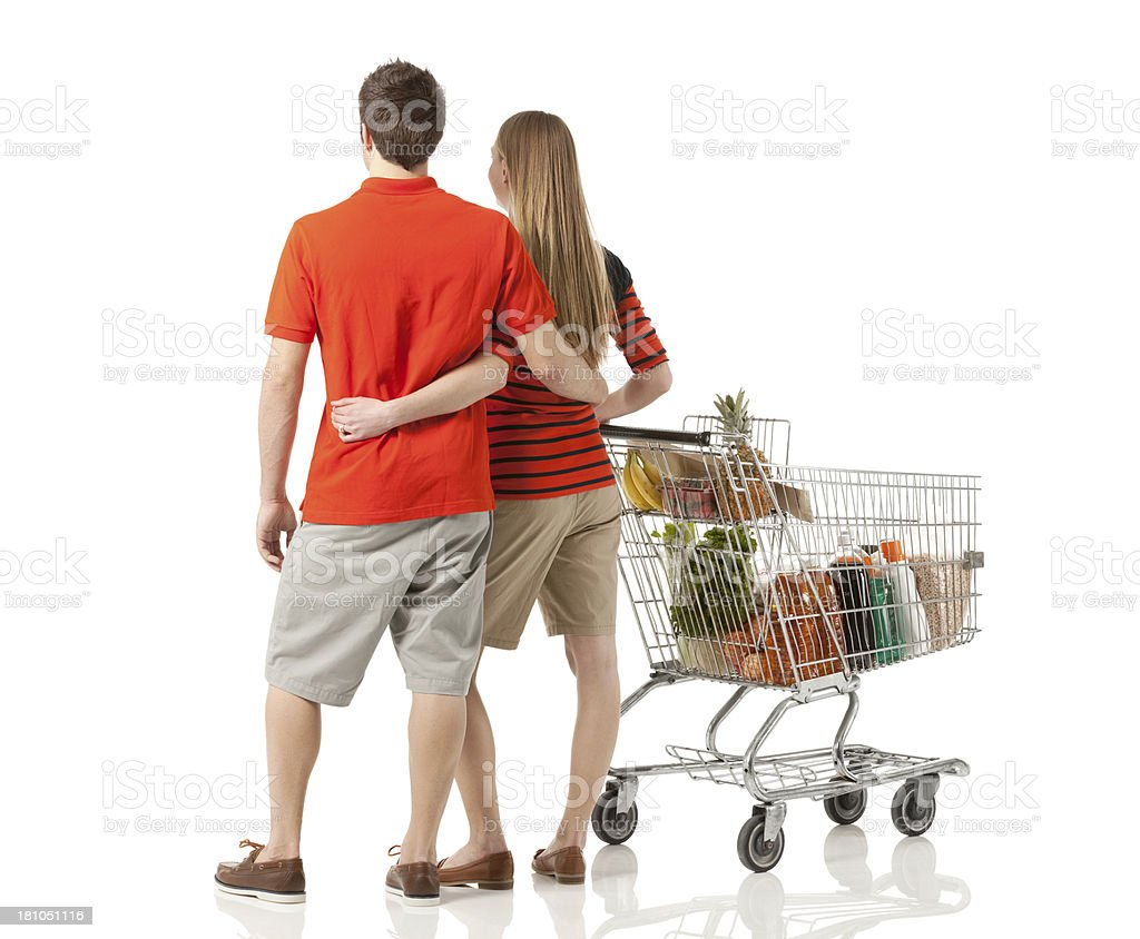 Couple walking with shopping cart stock photo