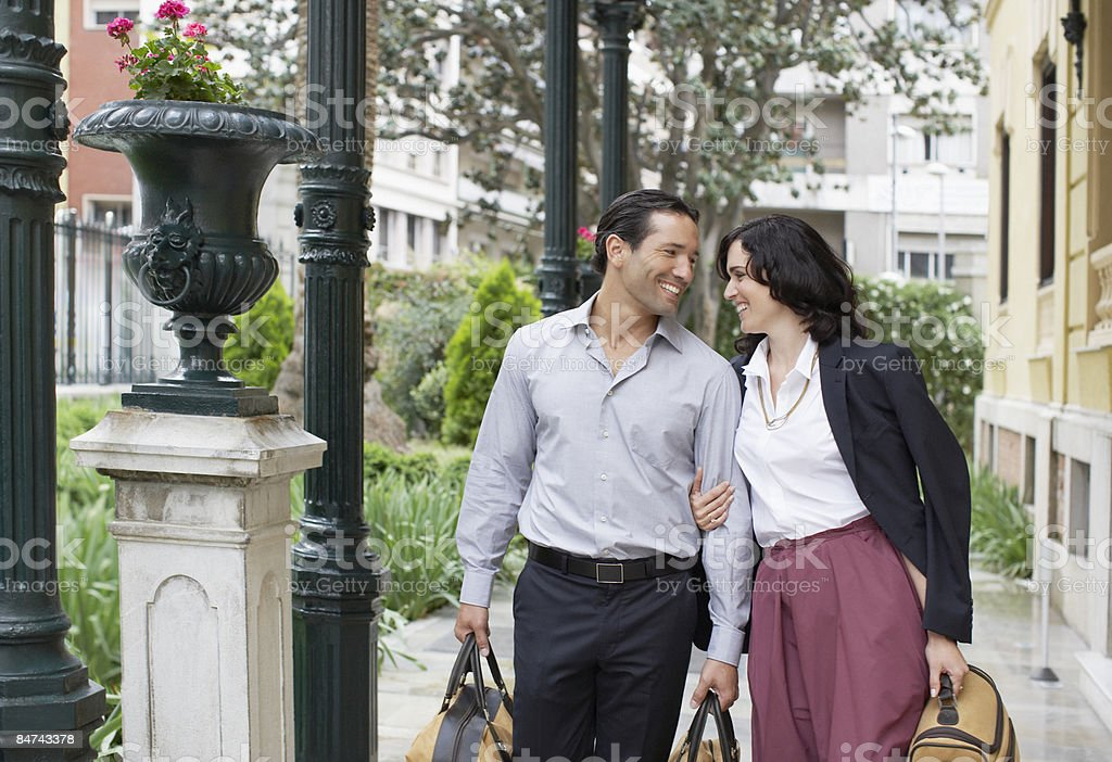 Couple walking with suitcases royalty-free stock photo