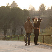 istock Couple walks along road in the evening 1067522500