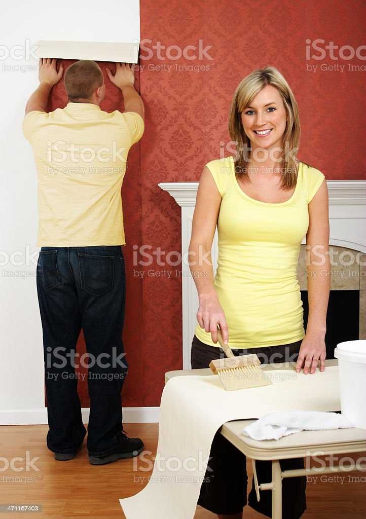 Couple Wallpapering royalty-free stock photo