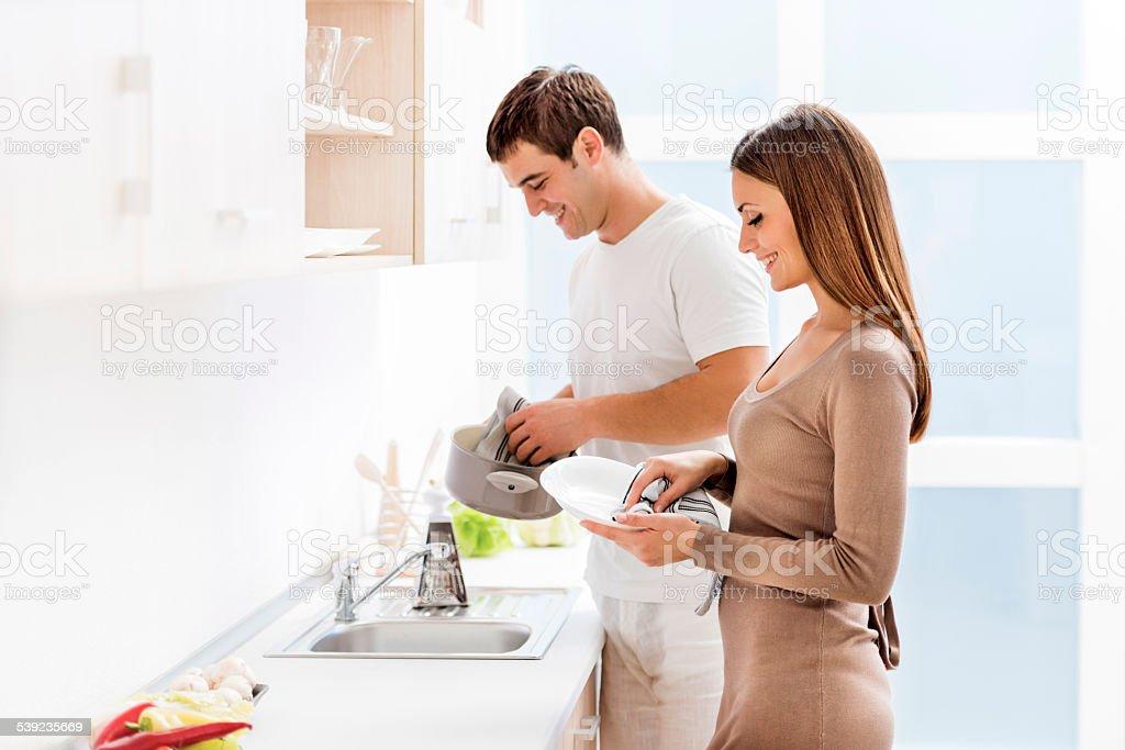 Couple washing dishes. stock photo