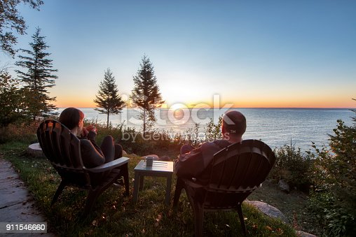 876420064istockphoto Couple watching a beautiful sunrise together 911546660