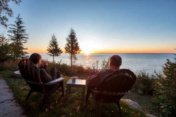 Couple watching a beautiful sunrise together Couple - Relationship, Sunset, Sunrise - Dawn, Togetherness, woodland minnesota stock pictures, royalty-free photos & images