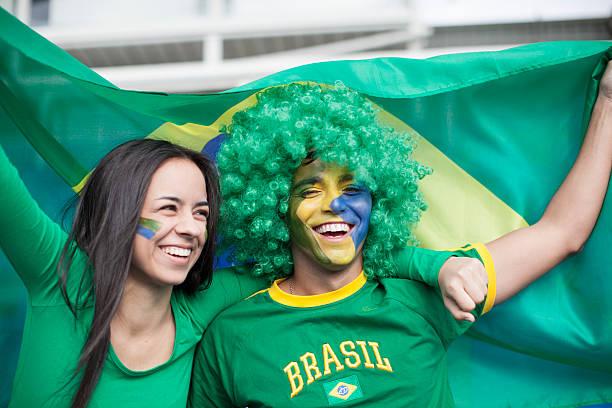 Couple watching a Brazilian Football Game. stock photo